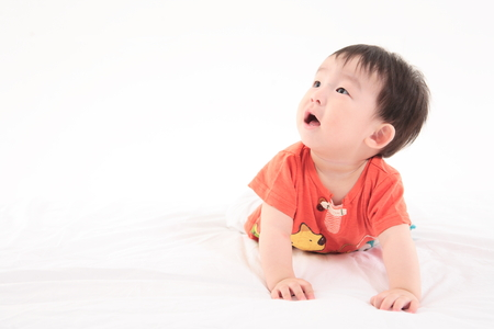 baby facial expressions: Asian baby boy in studio - isolated on white Stock Photo