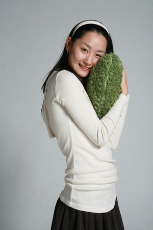 dimple: Young asian woman in studio