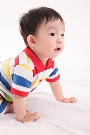 Asian baby boy in studio - isolated on white Stock Photo