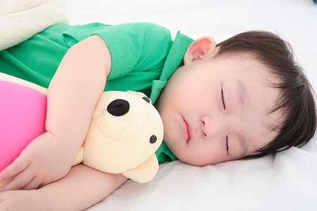 Asian baby boy in studio - isolated on white Banco de Imagens