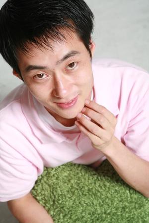 Young asian man in studio 版權商用圖片