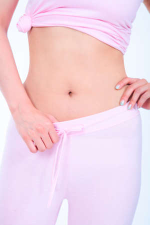 bodycare: Diet concept - close up shot of young Asian womans belly Stock Photo