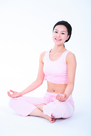 bodycare: Diet concept - Young Asian woman stretching, doing yoga poses Stock Photo