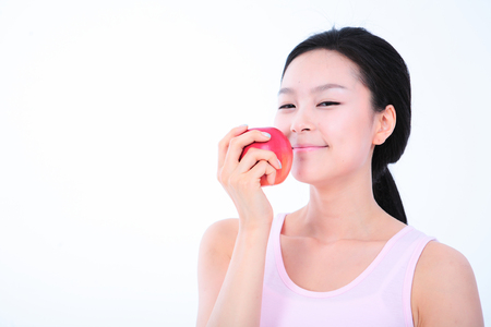 bodycare: Diet concept - Young Asian woman with an apple Stock Photo