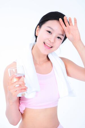 undergarments: Diet concept - Young Asian woman posing with towel and a glass of water
