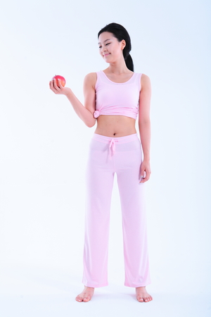 undergarments: Diet concept - Young Asian woman with an apple Stock Photo