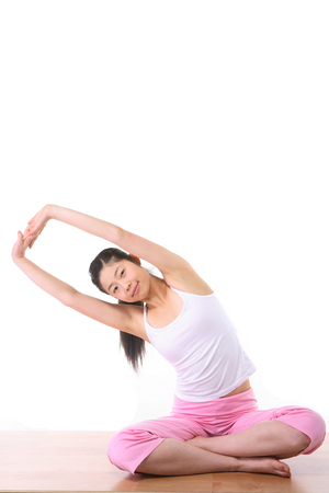 Young Asian woman doing yoga poses - isolated on white