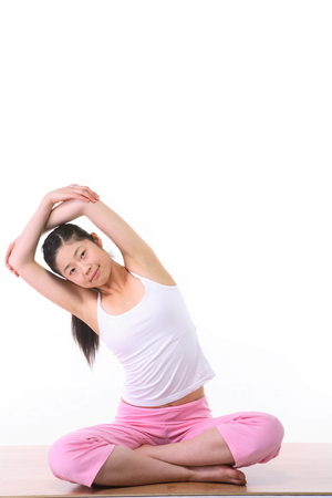 legged: Young Asian woman doing yoga poses - isolated on white