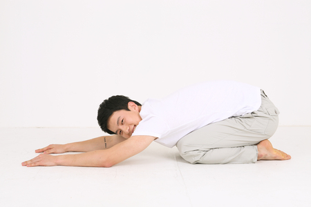 mental activity: Young Asian man doing yoga poses - isolated on white Stock Photo