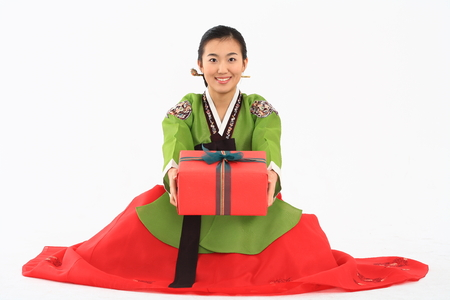 Korean young woman with traditional clothing - isolated on white Stock Photo