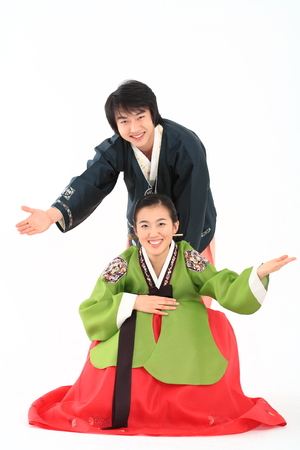 Korean couple with traditional clothing - isolated on white