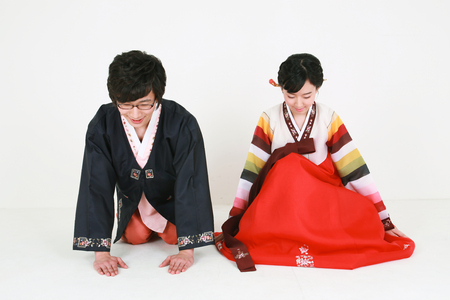Korean young couple with traditional clothing - isolated on white Stock Photo