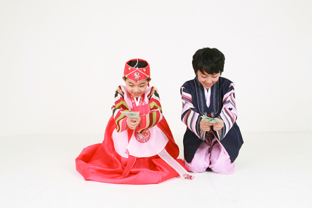 Korean kids with traditional clothing - isolated on white