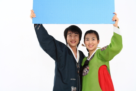hanbok: Korean couple with traditional clothing - isolated on white