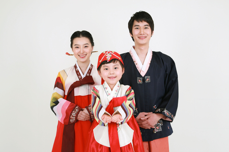 Korean family with traditional clothing - isolated on white