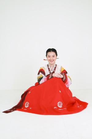 Korean woman with traditional clothing - isolated on white