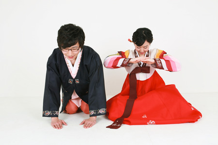 hanbok: Korean young couple with traditional clothing - isolated on white Stock Photo