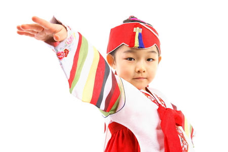 mladistvý: Korean little girl with traditional clothing - isolated on white