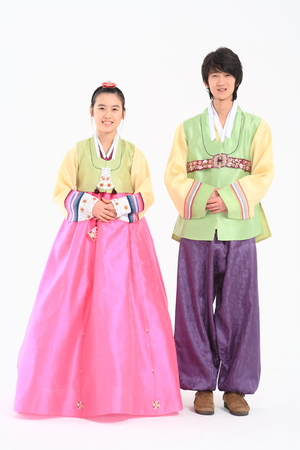 Korean young man and woman with traditional clothing - isolated on white
