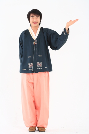 Young korean man with traditional clothing - isolated on white