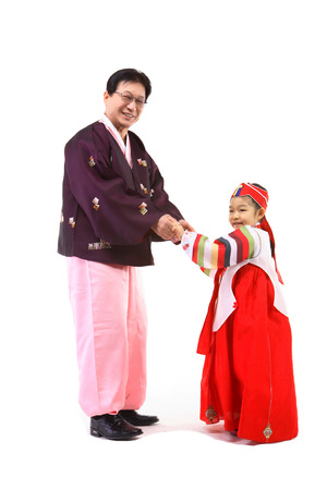 Korean grandfather and little girl with traditional clothing - isolated on white Stock Photo