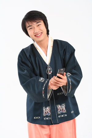 hanbok: Young korean man with traditional clothing - isolated on white