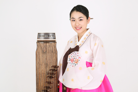 hanbok: Asian woman with traditional clothing playing musical instrument - isolated on white Stock Photo