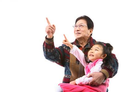 Korean grandfather in studio - isolated on white와 소녀 Stok Fotoğraf