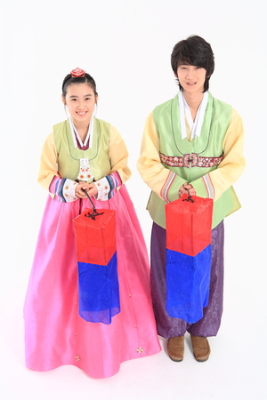 hanbok: Korean young man and woman with traditional clothing - isolated on white