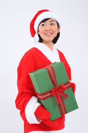 Asian woman with santa outfit and gifts- isolated on white Stock Photo
