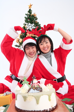 snow man party: Asian couple with santa outfit - isolated on white