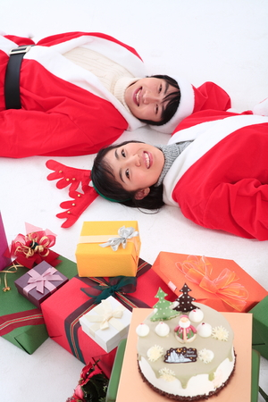 Asian couple with santa outfit - isolated on white