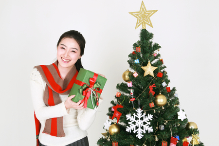scarves: Young korean woman beside christmas tree - isolated on white