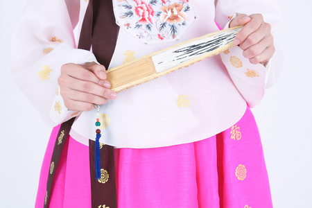 hanbok: Asian woman with traditional clothing perfoming traditional play - isolated on white