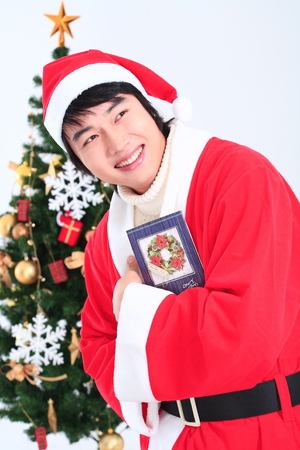 snow man party: Asian man with santa outfit and gifts- isolated on white Stock Photo