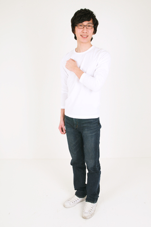 Young asian man neatly dressed - isolated on white Stock Photo