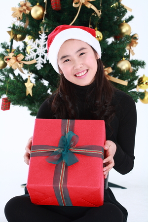 Asian girl with santa outfit and gifts- isolated on white Stock Photo