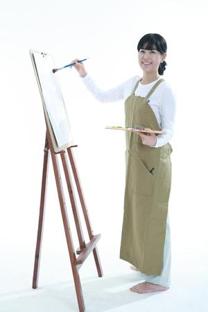 白で隔離 - アートを専攻しているアジアの女性 写真素材