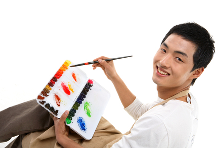 Asian man majoring in art - isolated on white Stock Photo