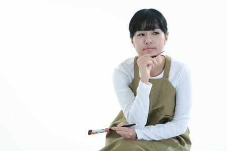 Mujer asiática majoring en el arte - aislados en blanco Foto de archivo - 81407784