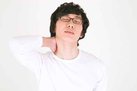 exhausting: Young asian man neatly dressed - isolated on white Stock Photo