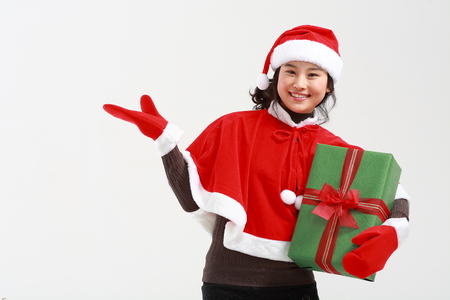 Asian man with santa outfit and gifts- isolated on white Stock Photo