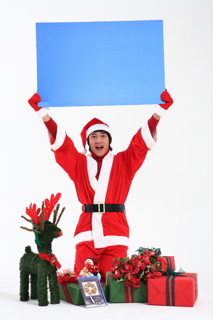 enlargement: Asian man with santa outfit and gifts- isolated on white Stock Photo