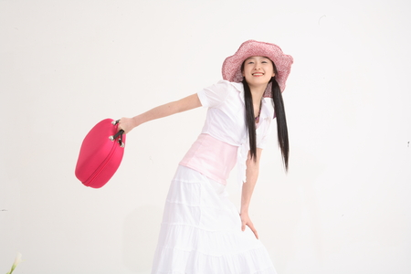 Young asian woman wearing big straw hat for picnic concept in studio - isolated on white