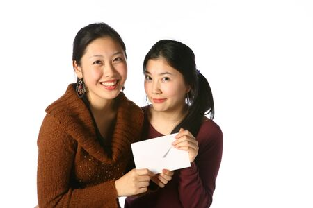 Two asian woman in studio - isolated on white Stok Fotoğraf - 81408294