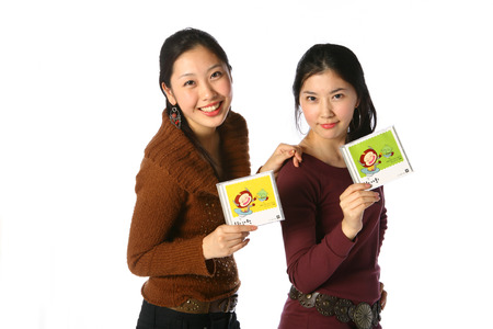 Two asian woman in studio - isolated on white