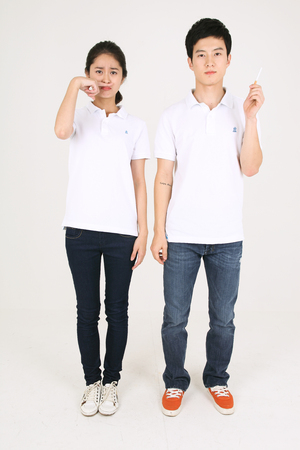 No smoking concept - Young Asian couple posing in the studio