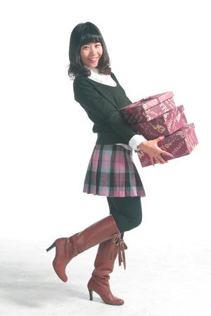 Asian woman wearing school uniform in studio - isolated on white Stock Photo