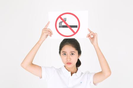 No smoking concept - Beautiful Asian girl posing with no smoking sign