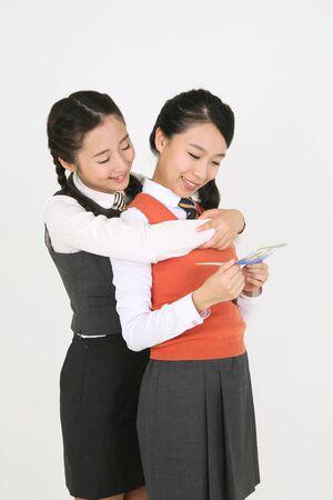 pranks: Asian girls in school uniform holding bank account books